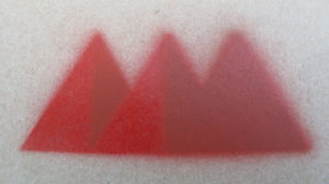 name logo spray painted on metal