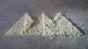 name logo in piles of sawdust